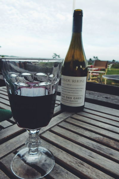 a glass of red wine Wine Wineglass Wine Bottle Outdoors Restaurant Table View Summer Wine Moments