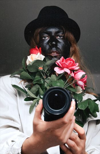 Portrait of person holding camera