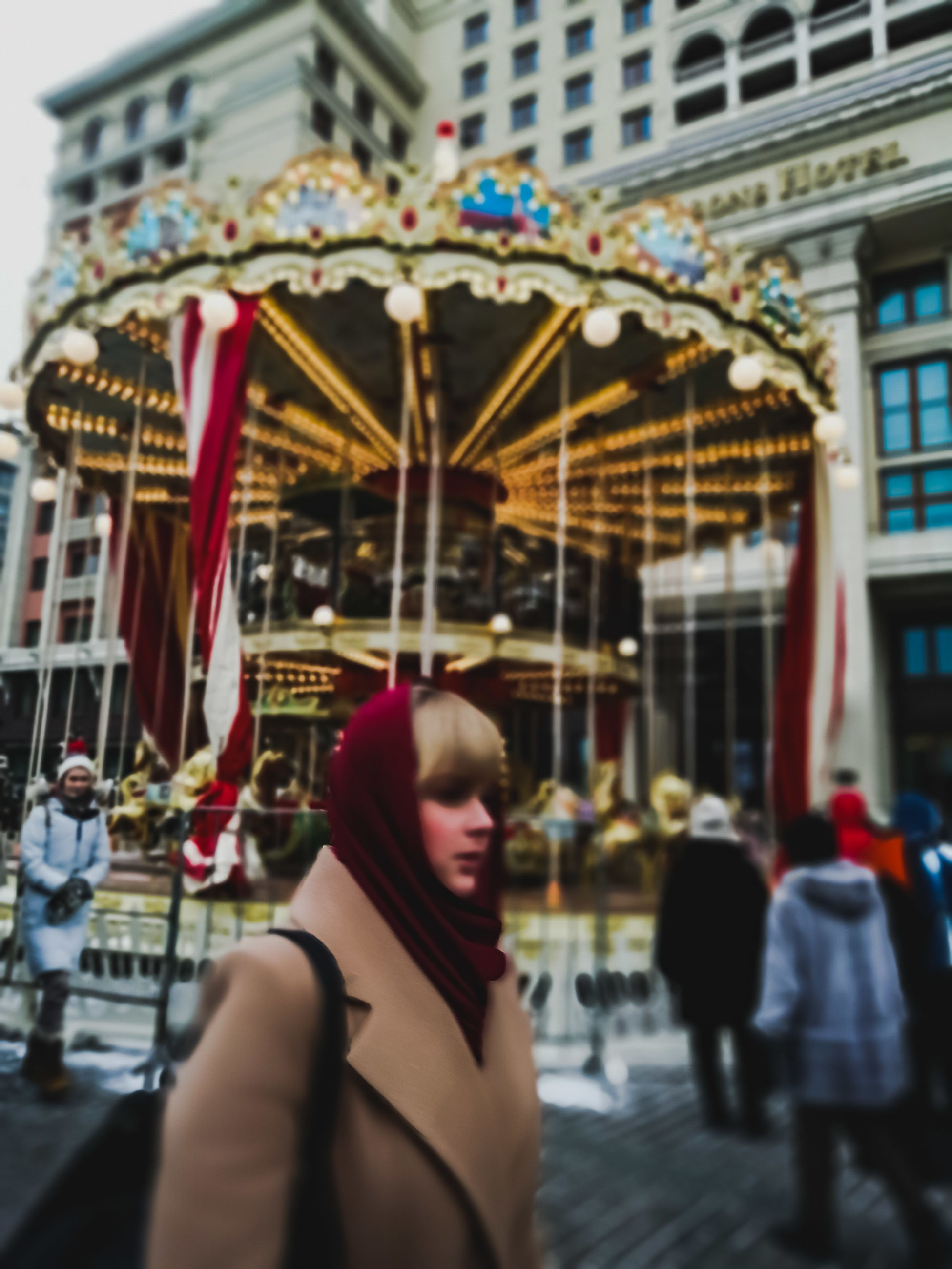building exterior, architecture, built structure, real people, lifestyles, leisure activity, women, one person, city, day, incidental people, city life, street, adult, clothing, young adult, amusement park, outdoors, young women, hairstyle
