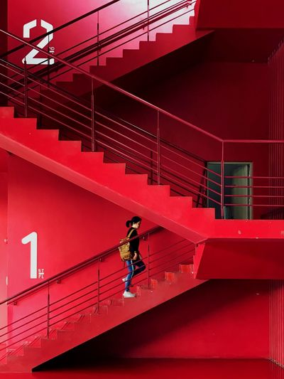Asian Woman level up to 2nd floor Lifestyles Urban Casual Clothing Number 2 1 Backpack Future Stair Passion Level Up Vivid Running Walking Asian  Step Up Woman Full Length Staircase Real People Leisure Activity Side View Red Connection Adult Wall - Building Feature Building Exterior