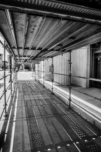 Architecture Baracade Barrier Black & White Black And White Built Structure Construction Construction Work Day Indoors  No People Sidewalk Walkway