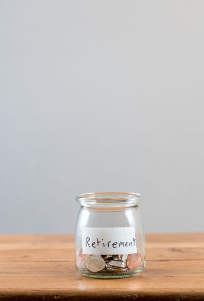 Lack of sufficient savings for retirement or old age with a saving jar with little cash Poor  Bankrupt Cash Finance Loose Change No People Not Enough Old Age Pension Poverty Problem Problems Retirement Retirement Plan Savings Shortage Shortfall Social Security Studio Shot