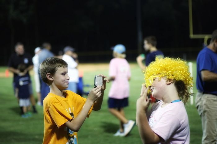 Childhood Elementary Age Leisure Activity Girls Lifestyles Focus On Foreground Boys Casual Clothing Cute Innocence Motion Enjoyment Togetherness Person Fun Fragility at local Friday night football Bluffton Sc, South Carolina
