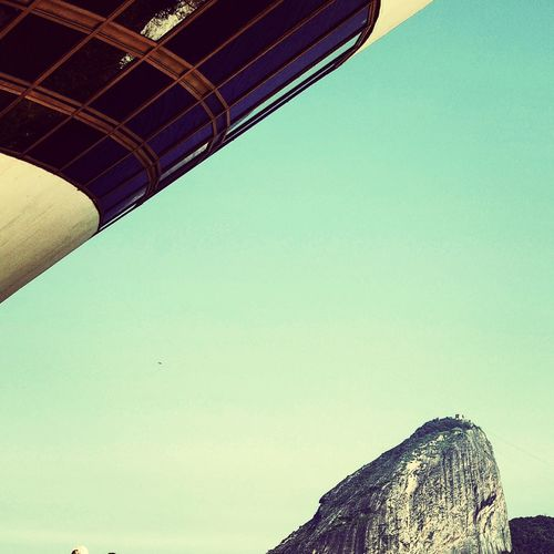 Niemeyer museum of contemporary arts and mountain against clear sky