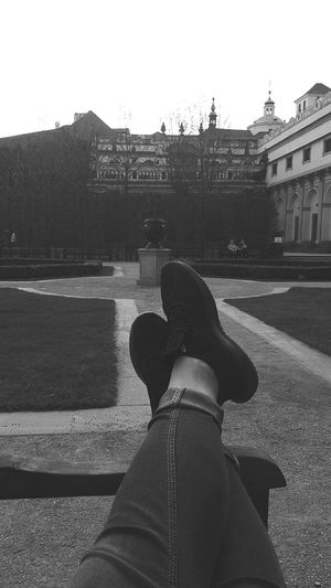 Low Section Human Leg Sitting Personal Perspective Shoe Sky