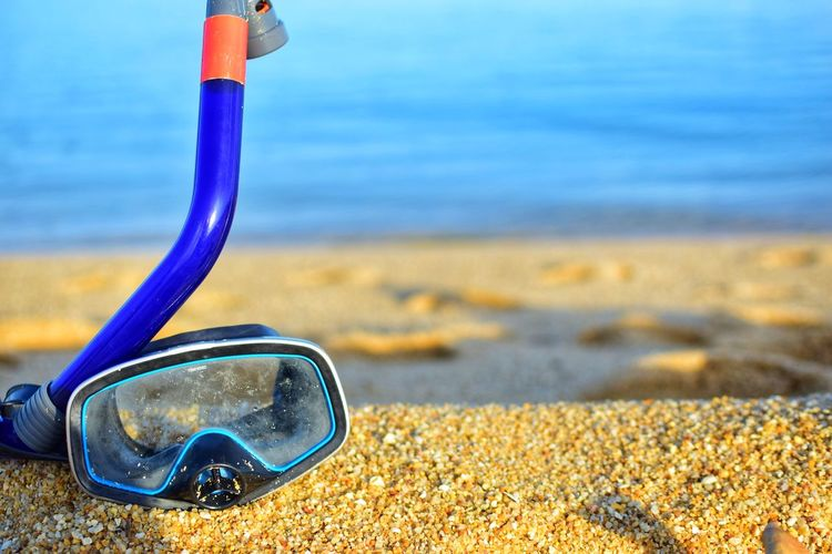 Diving Goggles lying on the sandy on sandy texture, blurred vacation concept. Ko Samui Relaxing Scuba Diving Snorkeling Thailand Tube Vacations Adventure Backgrounds Beach Close-up Diving Goggles Getting Inspired Holding Island Leisure Activity Mask Outdoors Sand Scene Sea Snorkel Sport Travel Destinations Tropical