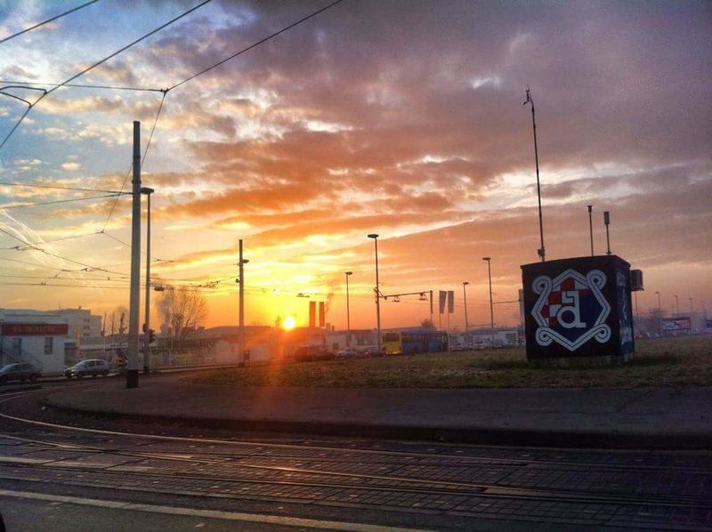Transportation Business Finance And Industry Railroad Track Power Line  Rail Transportation Sky Sunset Cloud - Sky Electricity  No People Road Industry City Electricity Pylon Road Sign Outdoors Day