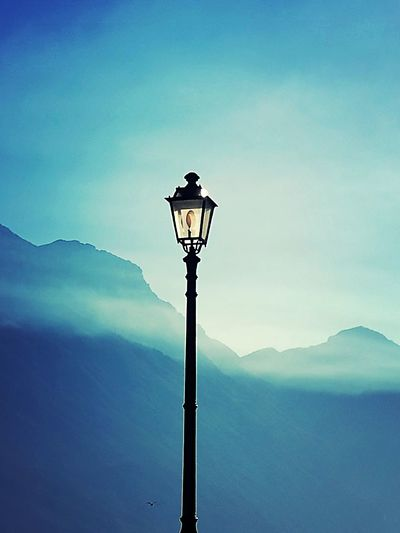 Sky Lighting Equipment Technology No People Nature Outdoors Tranquility Landscape Beauty In Nature Day Beauty Tranquility Photography Tranquil Scene Colour Photography Italy Nature Scenics Travel Destinations City Mountain Beauty In Nature Building Exterior Lake Gardalake
