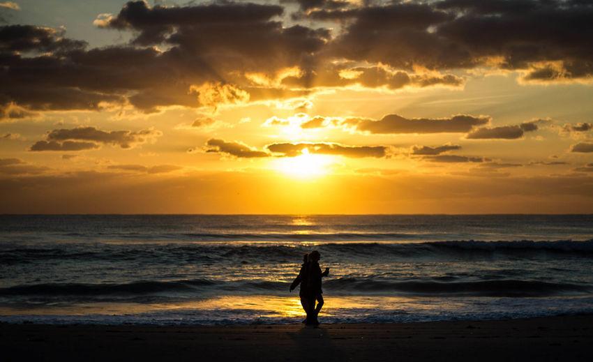 Beach Photography Beach Beauty In Nature Horizon Horizon Over Water Ocean Passing Strangers Real People Scenics - Nature Sea Silhouette Sky Sunrise Sunset Water Women
