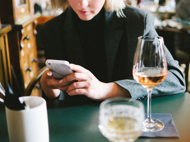 checking checking Alcohol Communication Drink Drinking Glass Focus On Foreground Food And Drink Front View Holding Indoors  Leisure Activity Lifestyles Midsection Mobile Phone One Person Portable Information Device Real People Refreshment Smart Phone Technology Wine Wineglass Wireless Technology Women Young Adult Young Women