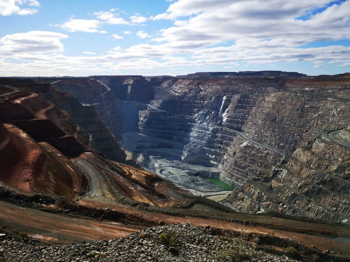 "The KCGM ""Super Pit"". Huaweip20pro Mine GoldMine Openpitmine Kalgoorlie WesternAustralia Superpit EyeEm Selects Mountain Sky Landscape Cloud - Sky"