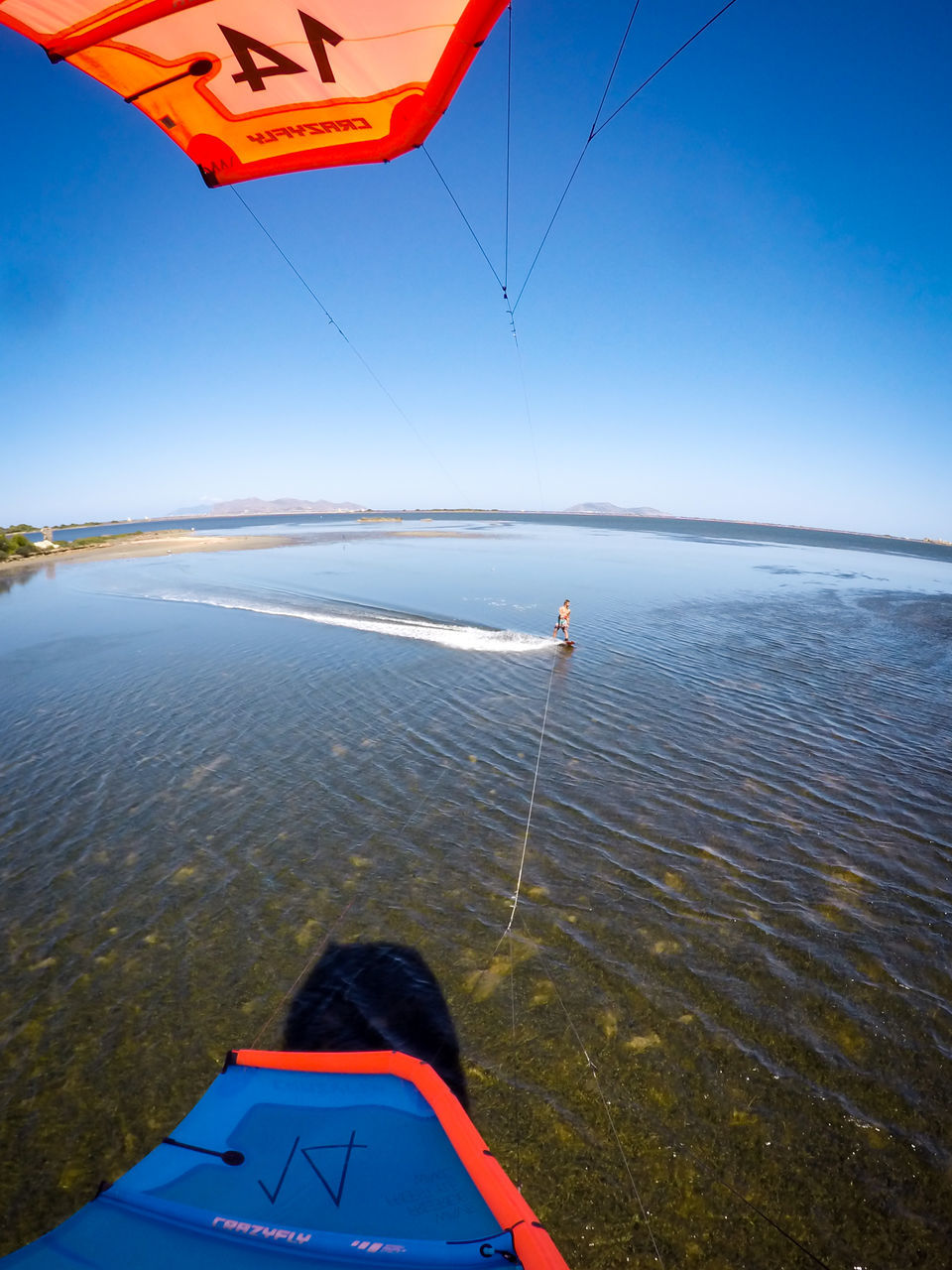 sea, real people, one person, nature, water, transportation, leisure activity, day, blue, scenics, beauty in nature, flying, rear view, men, tranquility, sky, adventure, mid-air, lifestyles, outdoors, air vehicle, vacations, horizon over water, people