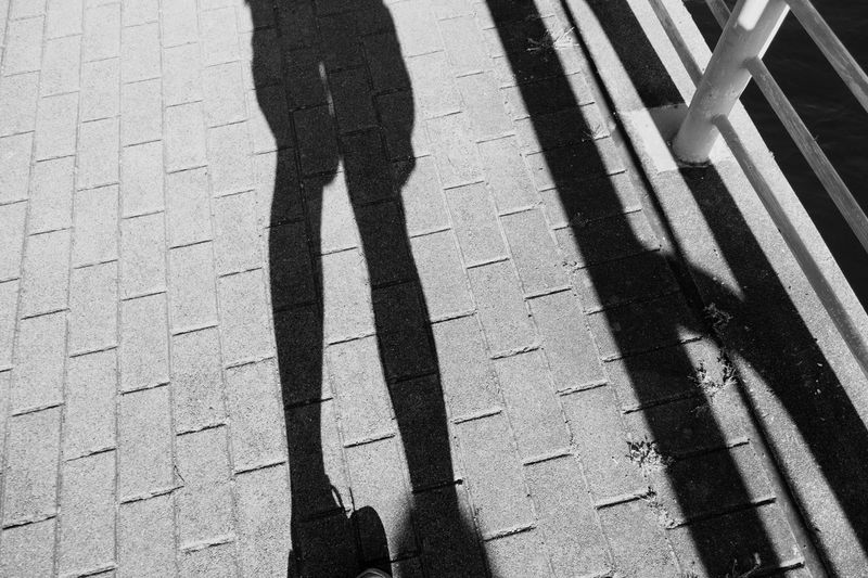 Shadow of person on street