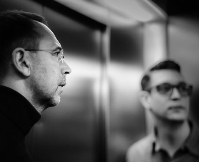 Elevator Blackandwhite Headshot Portrait Real People Young Adult Indoors  Eyeglasses  Glasses Focus On Foreground Profile View Elevator Blackandwhite Headshot Portrait Real People Young Adult Indoors  Eyeglasses  Glasses Focus On Foreground Profile View This Is Natural Beauty Human Connection Redefining Menswear