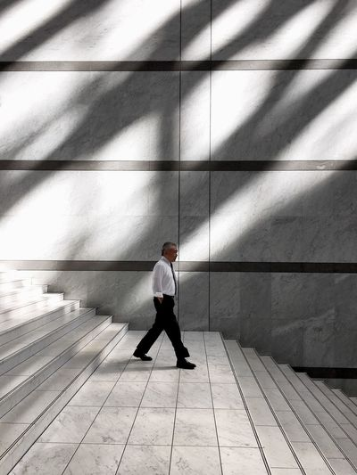 Full length of a man walking on staircase