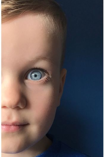 EyeEm Selects EyeEm Selects Childhood Human Eye One Person Close-up Blue Eyes Blue Looking At Camera Portrait Human Face Indoors  Headshot Boys Studio Shot Real People Human Body Part Eyeball Day People