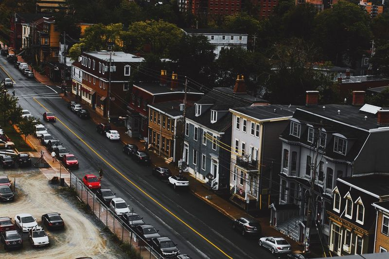 High angle view of cars on street in city