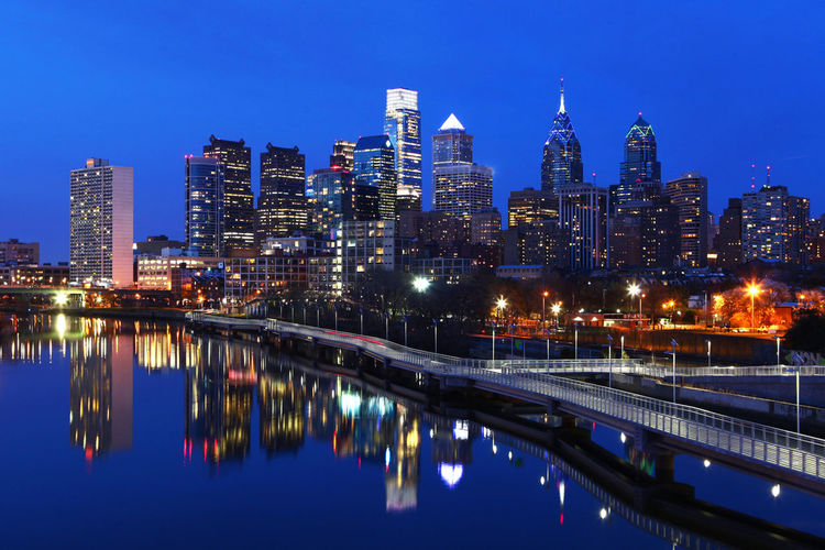 Night scene of the city of Philadelphia skyline Architecture Blue Building Exterior Built Structure City City Life Cityscape Clear Sky Illuminated Modern Night Outdoors Reflection River Sky Skyline Skyscraper Tower Travel Destinations Urban Skyline Water Waterfront