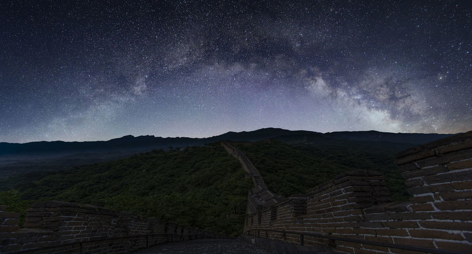 Scenic view of milky way over great wall of china
