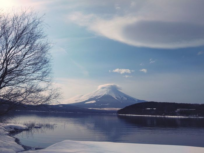 Scenic View Of Lake By Mt Fuji Against Sky During Winter