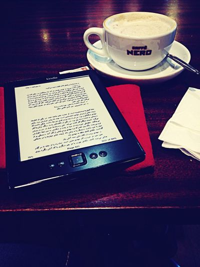 Enjoying my coffee and a lovely book سالهاي ابري