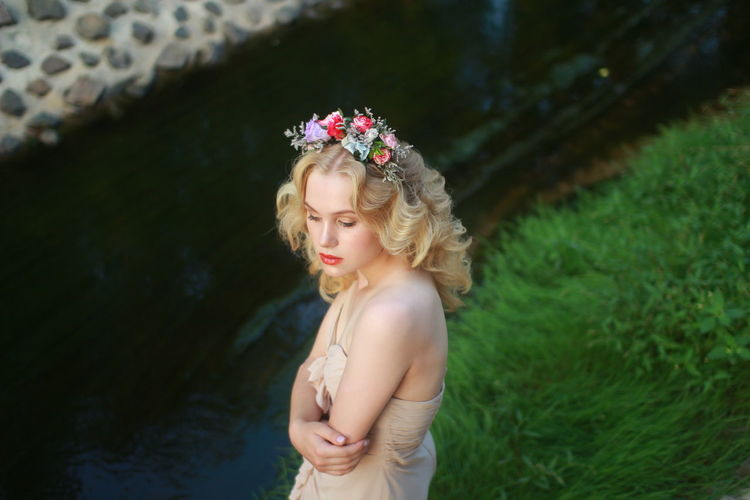 Grass Green Soft Beautiful Woman Blond Hair Bride Crown Day Flower Flower Band Flower Heads Laurel Wreath Outdoors Portrait Real People Standing Summer Tiara Warm Wedding Dress Young Women Summer Exploratorium