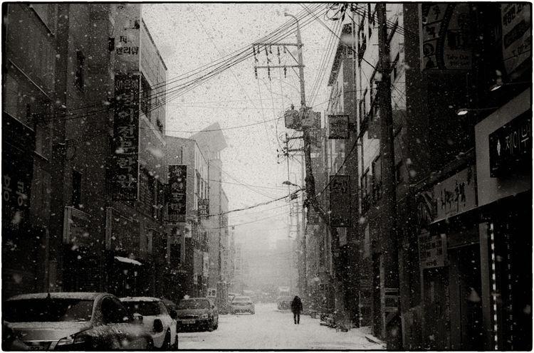 The weather was only better for a moment. Iksan, 2018. Leica M3, 50mm Summilux v2. Ilford HP5 at 3200. Tmax dev. Multigrade Print. 50mm Summilux ASIA City Life EyeEm Best Shots EyeEm Korea EyeEmNewHere Korea Leica M3 Print Seoul Buyfilmnotmegapixels Filmisnotdead Hp5 Ilford Leica Lens Pushed Film Snow Storm Cloud Street Photography