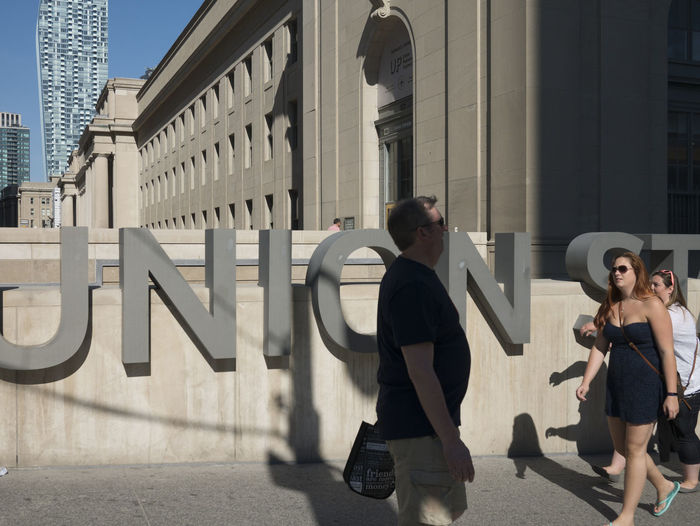 People walking in front of Union Station building and signage. Architecture Built Structure City City Life Lifestyles Toronto Tourist Tourist Attraction  Unionstation