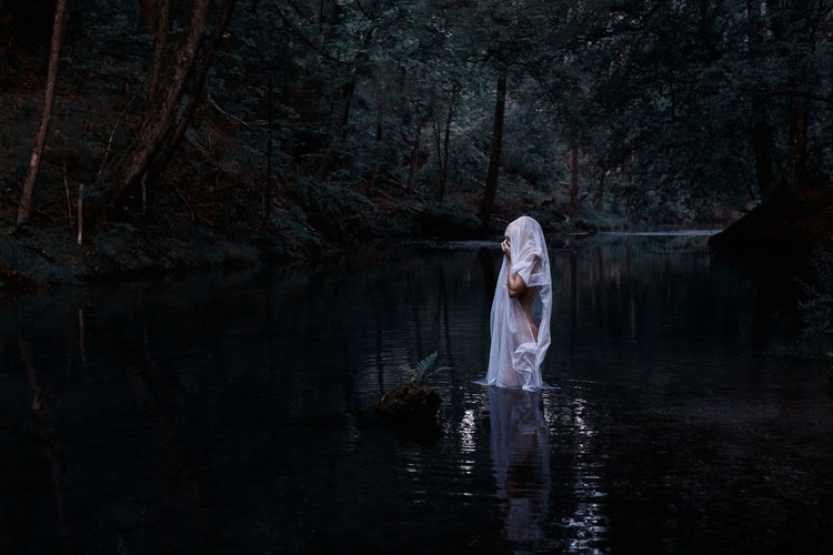 The Ghost - Fine Art Photograph of a woman standing in water Colours Creativity Fine Art Photography The Creative - 2018 EyeEm Awards Available Light Canon EOS 750D Canonphotography Contrast Fine Art Forest Ghost Lake Mood Nature One Person Outdoors Reflection Sigma 30mm/1.4 Art Spooky Standing Water White Women Young Women