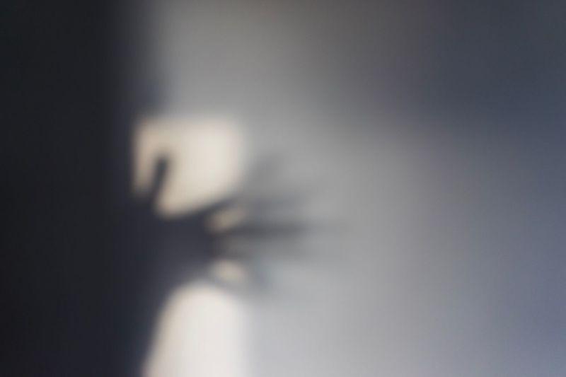 Defocused image of woman hand