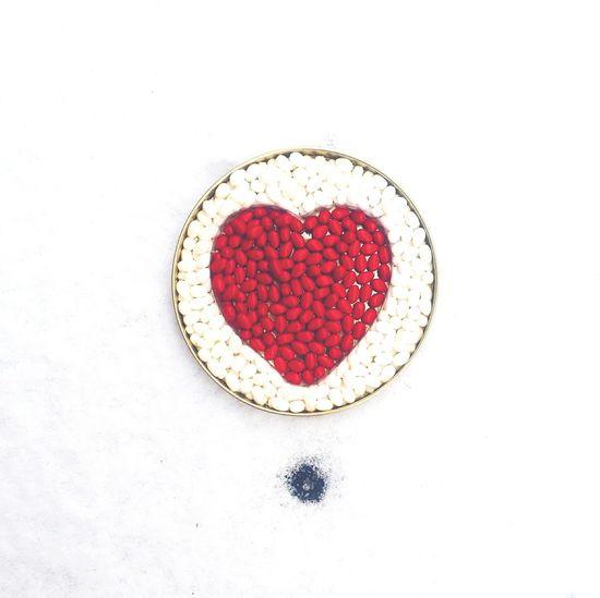 Close-up of heart shape on white background