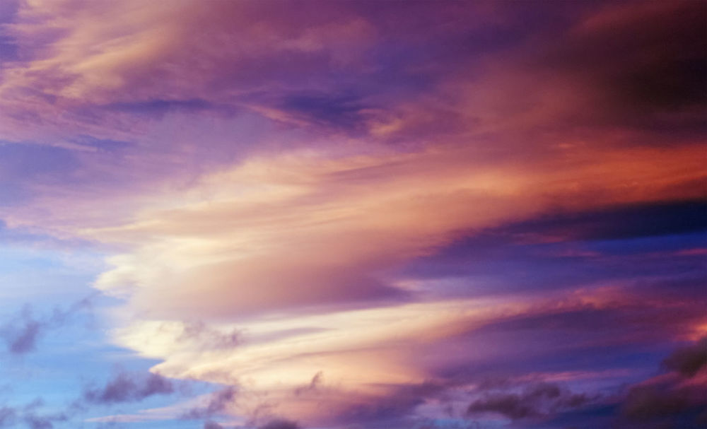 Dramatic cloud formation taking colour from sunset. Cloudscape Backgrounds Beauty In Nature Blue Cloud - Sky Cloudscape Color Colour Day Dramatic Sky Lenticular Cloud Low Angle View Nature No People Outdoors Scenics Sky Sky Only Sunset Tranquil Scene Tranquility
