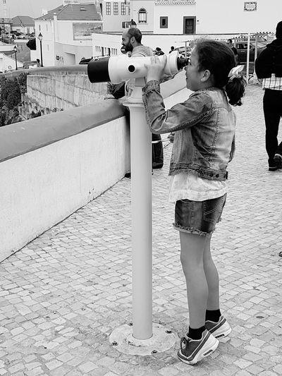 Full length of boy standing in city