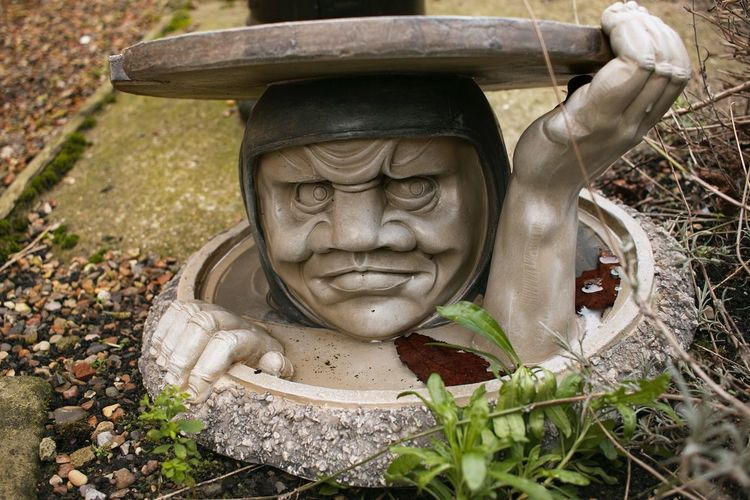 Whacky Drain Cover Statue Sculpture Outdoors No People Close-up Drain Drain Cover Ornament Garden Ornament
