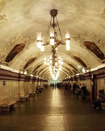 Moscow's metro Indoors  Ceiling Illuminated Large Group Of People Lighting Equipment Chandelier Arch Architecture Built Structure Subway Station Flooring Person Tourism Diminishing Perspective Travel Destinations Famous Place Architectural Feature Railroad Station City Life Casual Clothing Moscow Moscow City Moscowmetro Moscow Metro Stations Russia