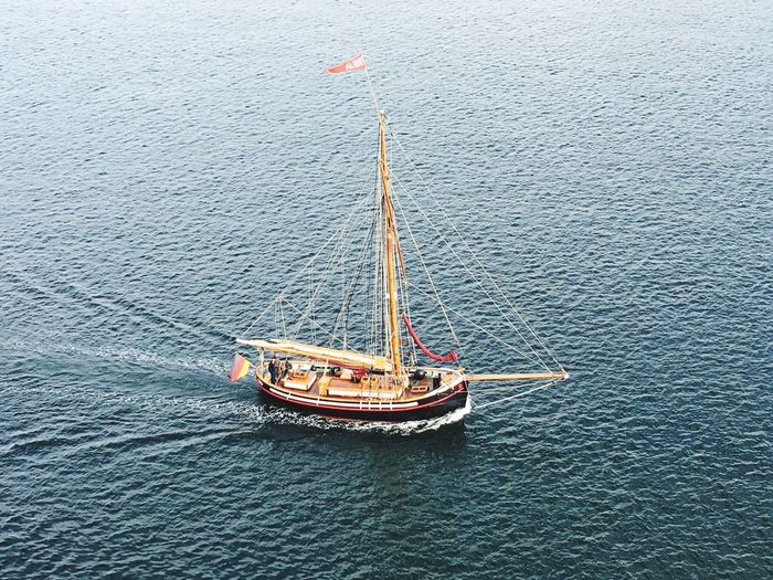 High Angle View Of Sailing Boat On Sea
