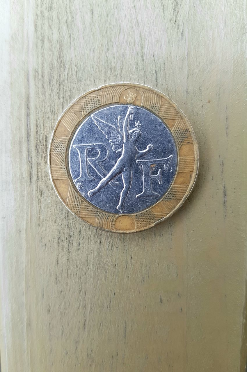 HIGH ANGLE VIEW OF COIN