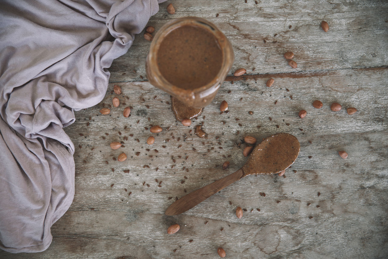 directly above, cup, food and drink, drink, table, coffee, coffee - drink, mug, coffee cup, refreshment, freshness, indoors, high angle view, wood - material, food, still life, kitchen utensil, spoon, eating utensil, one person