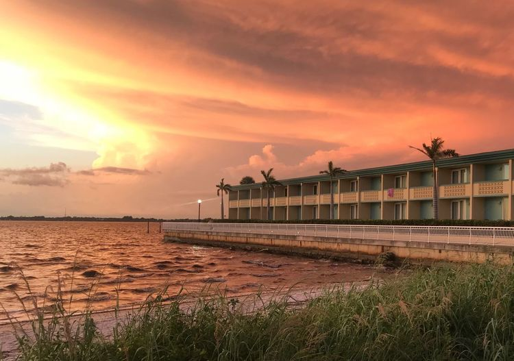 Sky Sunset Water Cloud - Sky Built Structure Architecture Orange Color Sea Scenics - Nature Beach Land Tranquil Scene Beauty In Nature Tranquility Building Exterior Pier Outdoors No People Nature