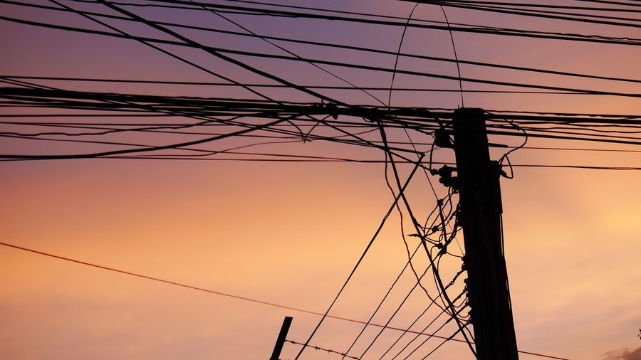 EyeEm Selects Cable Connection Power Supply Electricity  Power Line  Fuel And Power Generation Technology Sunset Complexity Silhouette Electricity Pylon Low Angle View Telephone Line Sky No People Outdoors Nature Network Connection Plug Day Evening Evening Sky Evening Sun Sunrise Sunset