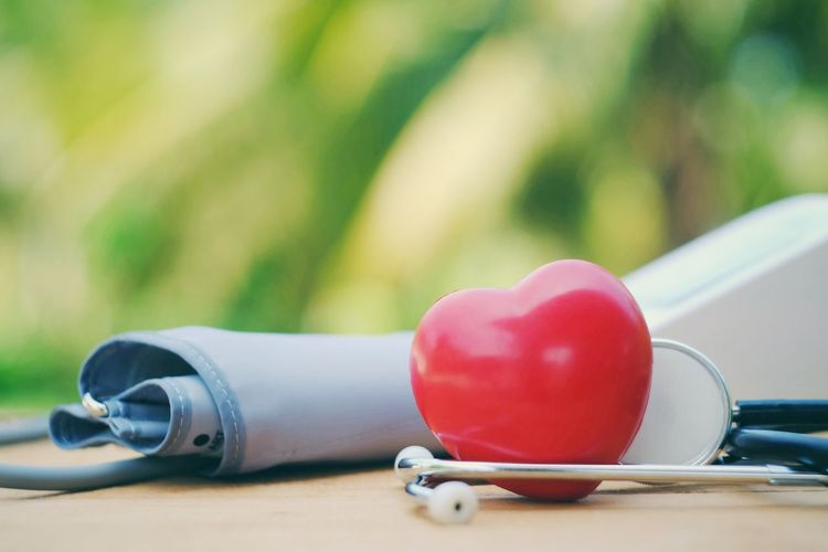 Red heart, stethoscope and blood pressure monitor on table Clinical Patient Injury Cure Health Medical Wellness Disease Diagnostic Physiotherapy Weakness Insurance Care Sick Healthcare Healthy Illness Accident Emergency Help Hospital Cardiac Cardiology Pulse Pressure
