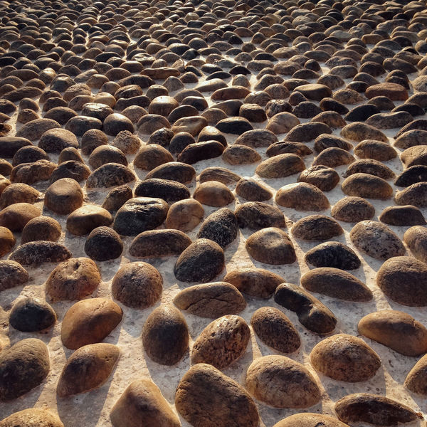 Street paved with stones Backgrounds Close-up Historic Medieval No People Old Town Outdoors Path Pathway Paved Paved Path Paved Road Pavedstreet Pedestrian Pedestrian Walkway Road Sand Stone Textured  Tourism Trip Walk Walking Way