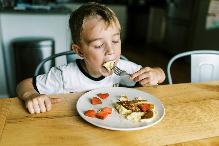 High angle view of man eating food