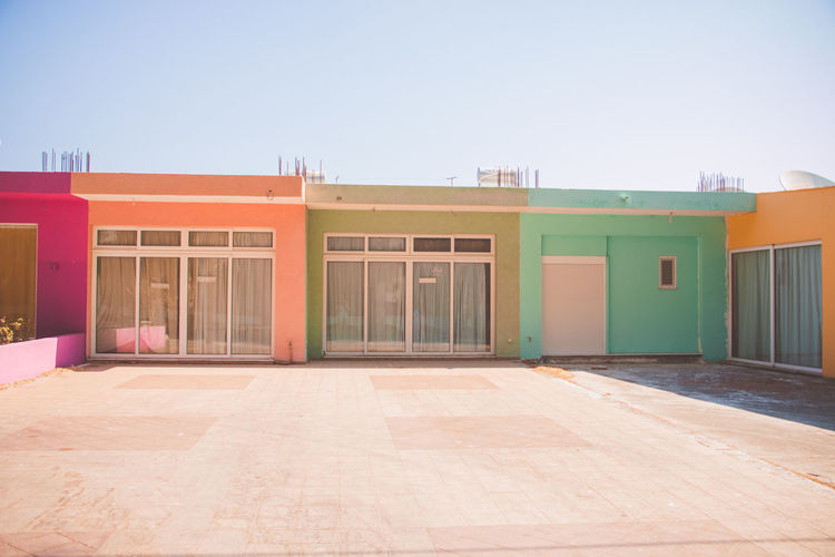 Holiday Rhodos, Greece  Summertime Architecture Building Building Exterior Built Structure City Clear Sky Copy Space Coulerful Town Day Door Entrance Glass - Material Modern Multi Colored Nature No People Orange Color Outdoors Sky Sunlight Window