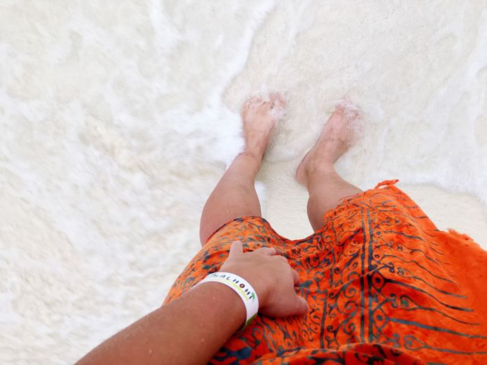 Selfie in orange dress on the beach on Maldives Water Wave Sea EyeEm Selects One Person Human Leg Body Part Real People Human Body Part Lifestyles Leisure Activity Low Section Adult Women Personal Perspective barefoot High Angle View Sand Human Limb Relaxation Beach Land Limb Lying Down