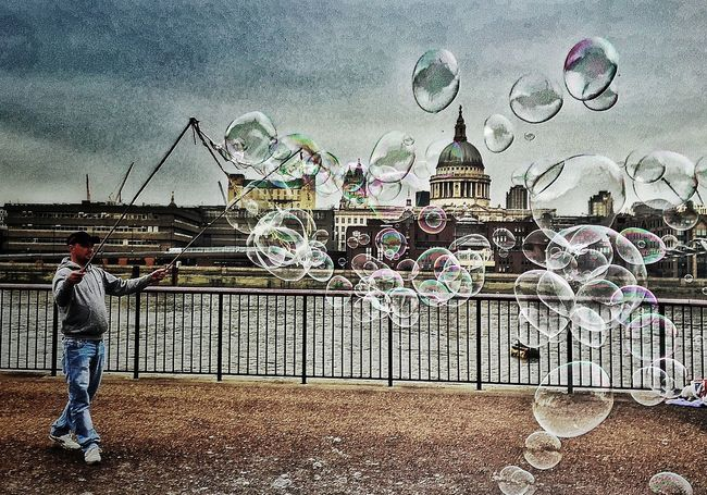 London street entertainer London Embankment City Capital Cities  St Paul's Cathedral Thames River Bubbles Street Entertainment Action Shot  Sky And Clouds Cityscapes The Tourist Up Close Street Photography The Street Photographer - 2016 EyeEm Awards