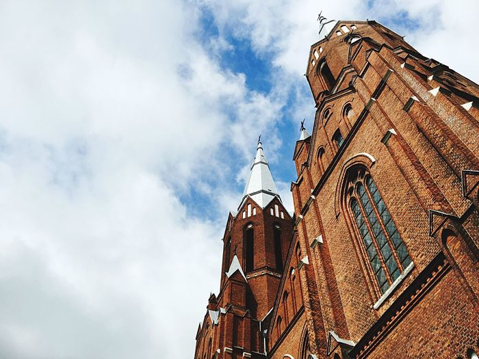 Low angle view of church against clouds