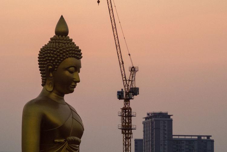 The giant golden buddha in wat paknam phasi charoen temple in phasi charoen district
