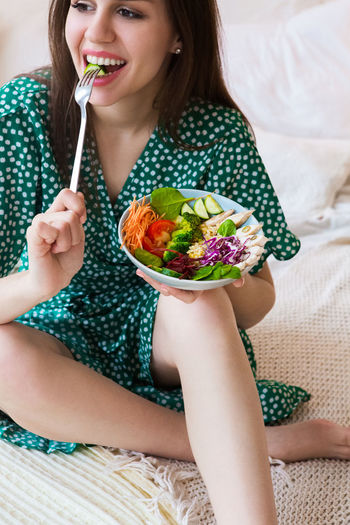 Midsection of woman eating food