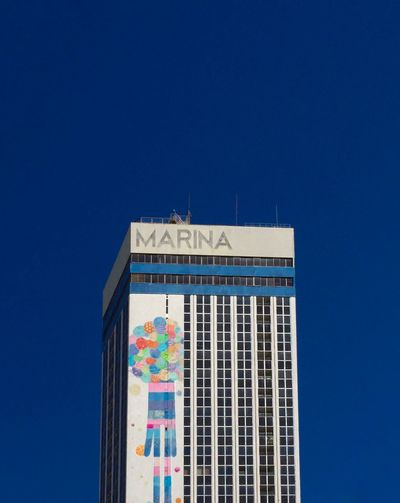 Marina The Architect - 2019 EyeEm Awards Sky Blue Copy Space Building Exterior Built Structure Clear Sky The Minimalist - 2019 EyeEm Awards Architecture No People Day Sunlight Nature Low Angle View Building Outdoors City Text Window Office Building Exterior Tower Tall - High